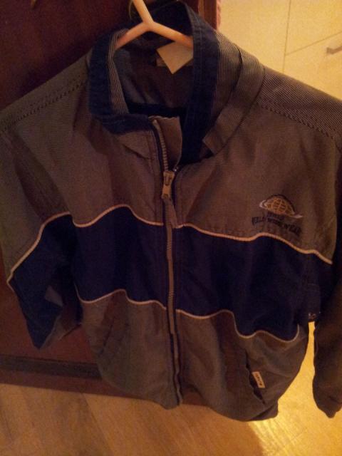 Temno modra prehodna  jakna  št. 134